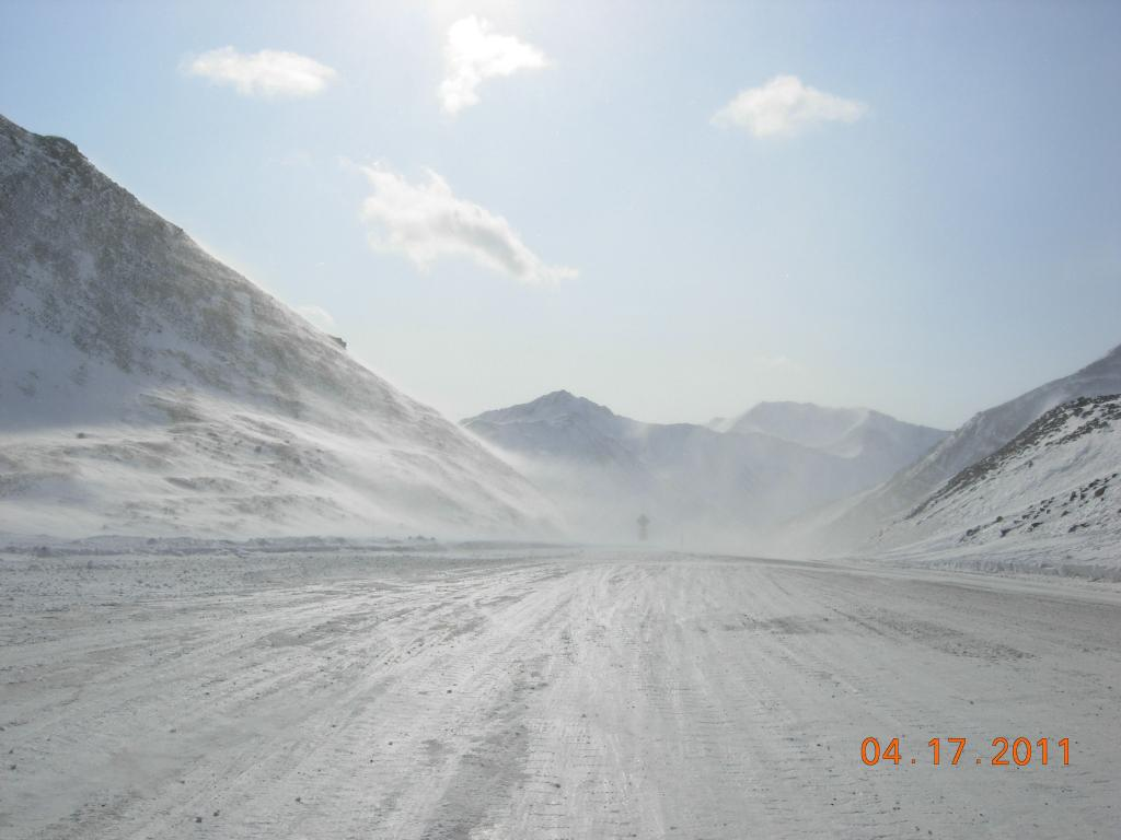 "Snowmobiles head north along the Dalton Highway towards the North Slope, for the 2011 Arctic Observing Network field season. (<a href=""/cryosphere/gallery/photo/33973"">View photo detail.</a>) <br>"