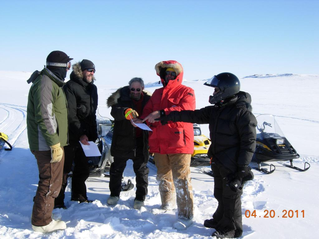 "Researchers consult their notes during the 2011 Arctic Observing Network (Snownet) project in Alaska. (<a href=""/cryosphere/gallery/photo/33982"">View photo detail.</a>) <br>"