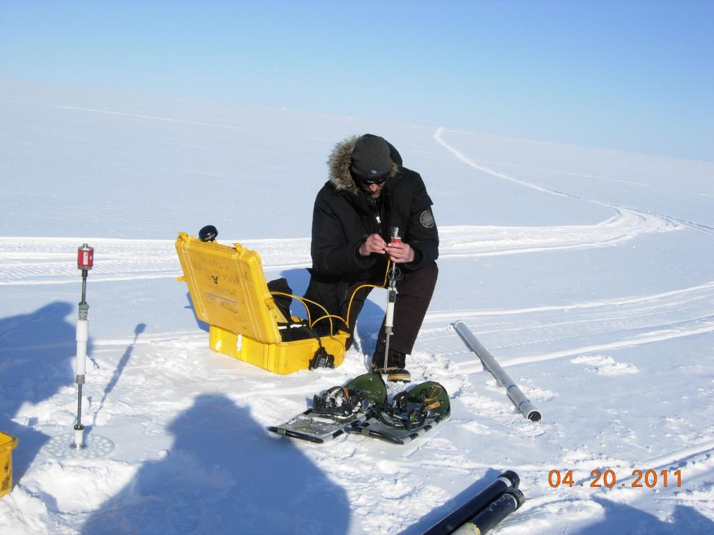 "Mark Parsons sets up research equipment during the 2011 Arctic Observing Network (Snownet) project in Alaska. (<a href=""/cryosphere/gallery/photo/33989"">View photo detail.</a>) <br>"