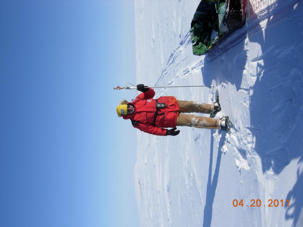 "Mark Serreze measures snow depthduring the 2011 Arctic Observing Network (Snownet) project in Alaska. (<a href=""/cryosphere/gallery/photo/33996"">View photo detail.</a>) <br>"