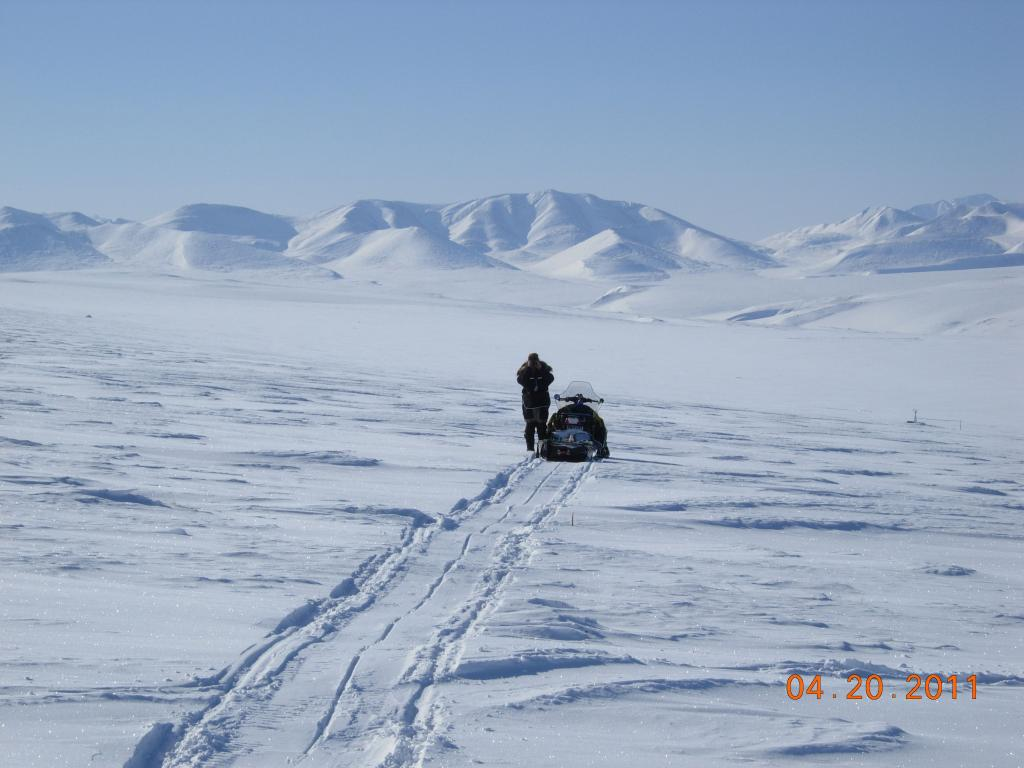 "An Arctic researcher and his snowmobile during the 2011 Arctic Observing Network (Snownet) project in Alaska. (<a href=""/cryosphere/gallery/photo/33992"">View photo detail.</a>) <br>"