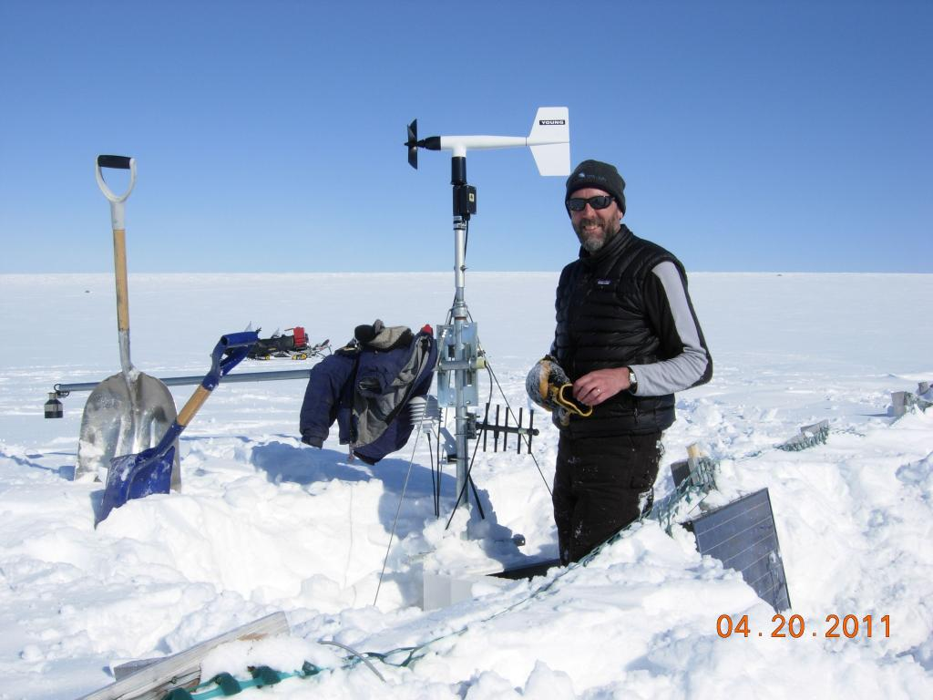 "Mark Parsons sets up a weather station during the the 2011 Arctic Observing Network (Snownet) project in Alaska. (<a href=""/cryosphere/gallery/photo/33985"">View photo detail.</a>) <br>"