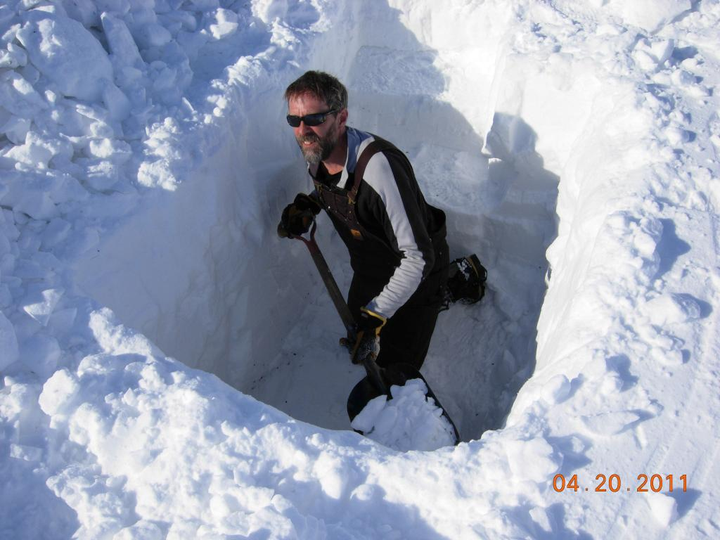 "Mark Parsons digs a snow pit to examine the properties of snow cover during  the 2011 Arctic Observing Network (Snownet) project in Alaska. (<a href=""/cryosphere/gallery/photo/33988"">View photo detail.</a>) <br>"