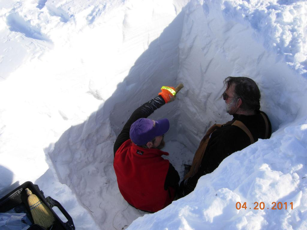 "Researchers Matthew Sturm (left) and Mark Serreze examine layers in a snow pit during the 2011 Arctic Observing Network (Snownet) project in Alaska. (<a href=""/cryosphere/gallery/photo/33987"">View photo detail.</a>) <br>"