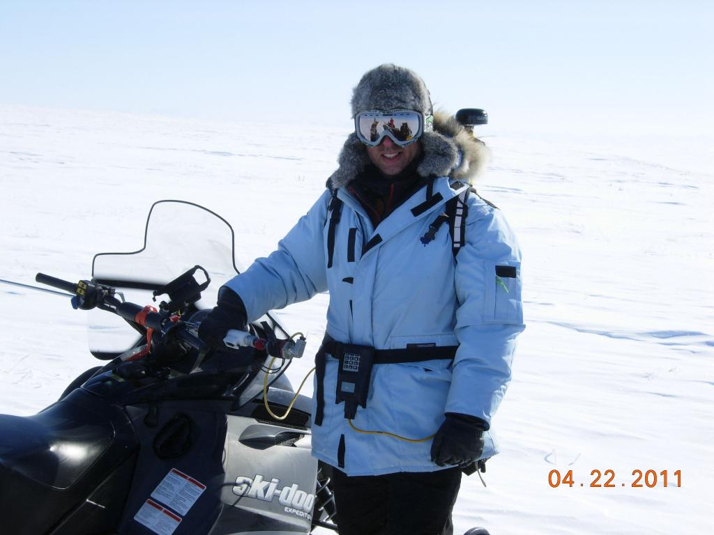 "Andrew Slater poses with a snowmobile during the 2011 Arctic Observing Network (Snownet) project in Alaska. (<a href=""/cryosphere/gallery/photo/33991"">View photo detail.</a>) <br>"