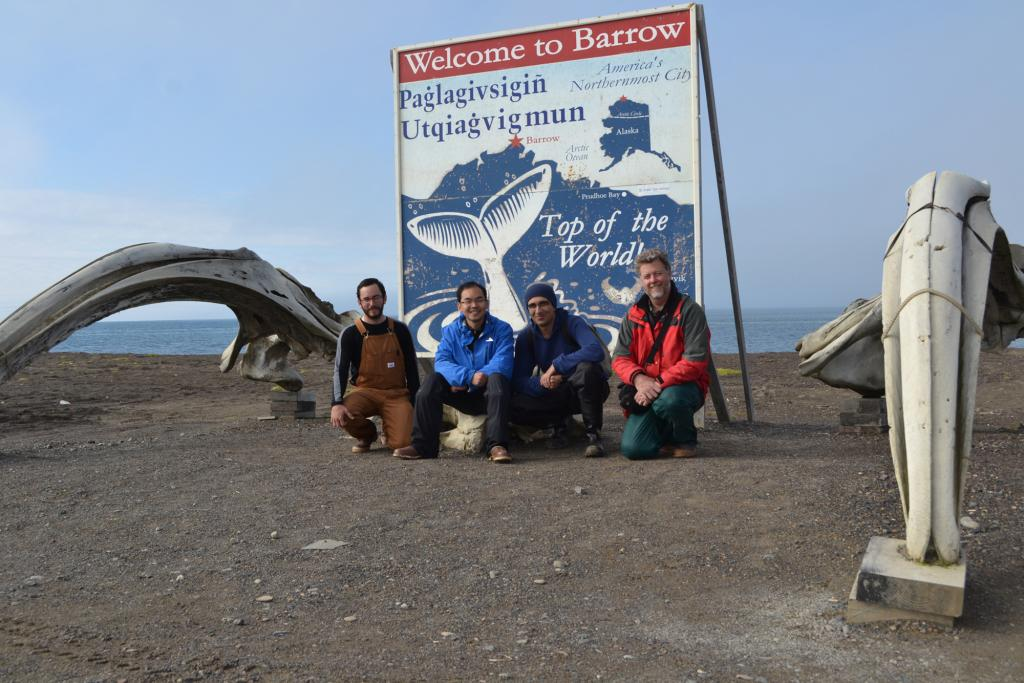 "Andy Persekian, Lin Liu, Elchin Jafarov, and Kevin Schaefer pose next to whale bones at the Welcome to Barrow, Alaska sign. (Credit: Elchin Jafarov, NSIDC) (<a href=""/cryosphere/gallery/photo/34157"">View photo detail.</a>) <br>"