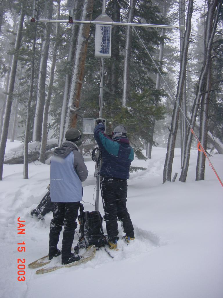 "Scientists check on a weather station during the 2002 Cold Land Processes Field Experiment. <a href=""http://nsidc.org/data/clpx/"">CLPX Web site</a> (<a href=""/cryosphere/gallery/photo/33597"">View photo detail.</a>) <br>"