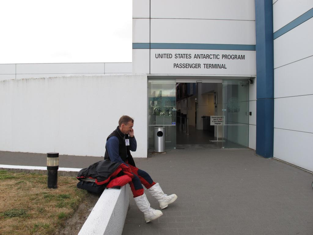 "Ted Scambos waits at the Antarctica terminal. Image Credit:  Ted Scambos, NSIDC (<a href=""/cryosphere/gallery/photo/33729"">View photo detail.</a>) <br>"