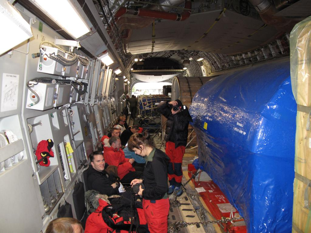 "A group of researchers sit in the airplane to McMurdo Station in Antarctica. Image Credit:  Ted Scambos, NSIDC (<a href=""/cryosphere/gallery/photo/33738"">View photo detail.</a>) <br>"