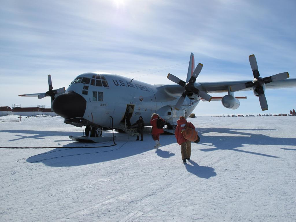 "Ted Scambos and the traverse team arrive at the South Pole, for the beginning of the U.S.-Norway Traverse of East Antarctica. Image Credit:  Ted Scambos, NSIDC (<a href=""/cryosphere/gallery/photo/33757"">View photo detail.</a>) <br>"
