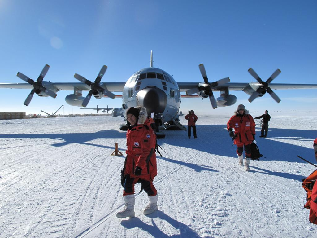 "The Norwegian-U.S. Traverse team disembarks from the LC-139 Hercules at the South Pole. Image Credit:  Ted Scambos, NSIDC (<a href=""/cryosphere/gallery/photo/33761"">View photo detail.</a>) <br>"