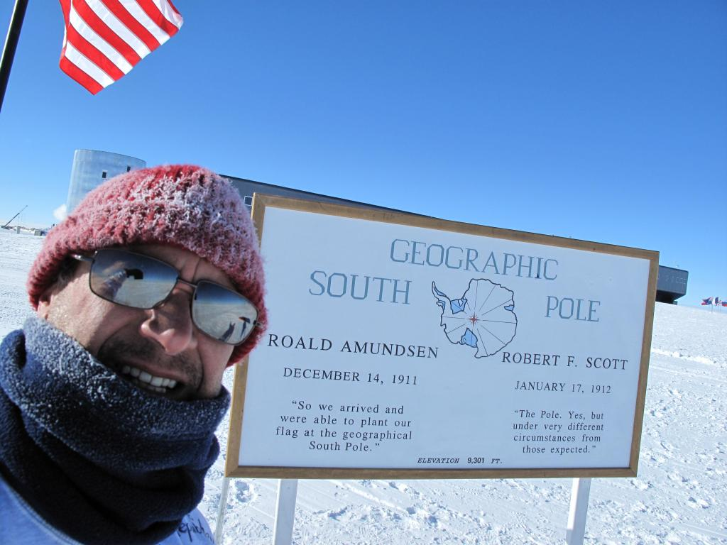"Ted Scambos poses in front of the geographic South Pole. Image Credit: Ted Scambos, NSIDC (<a href=""/cryosphere/gallery/photo/33785"">View photo detail.</a>) <br>"