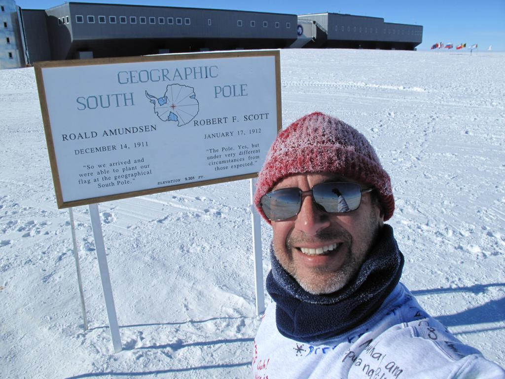 "Ted Scambos poses in front of the geographic South Pole. Image Credit: Ted Scambos, NSIDC (<a href=""/cryosphere/gallery/photo/33786"">View photo detail.</a>) <br>"
