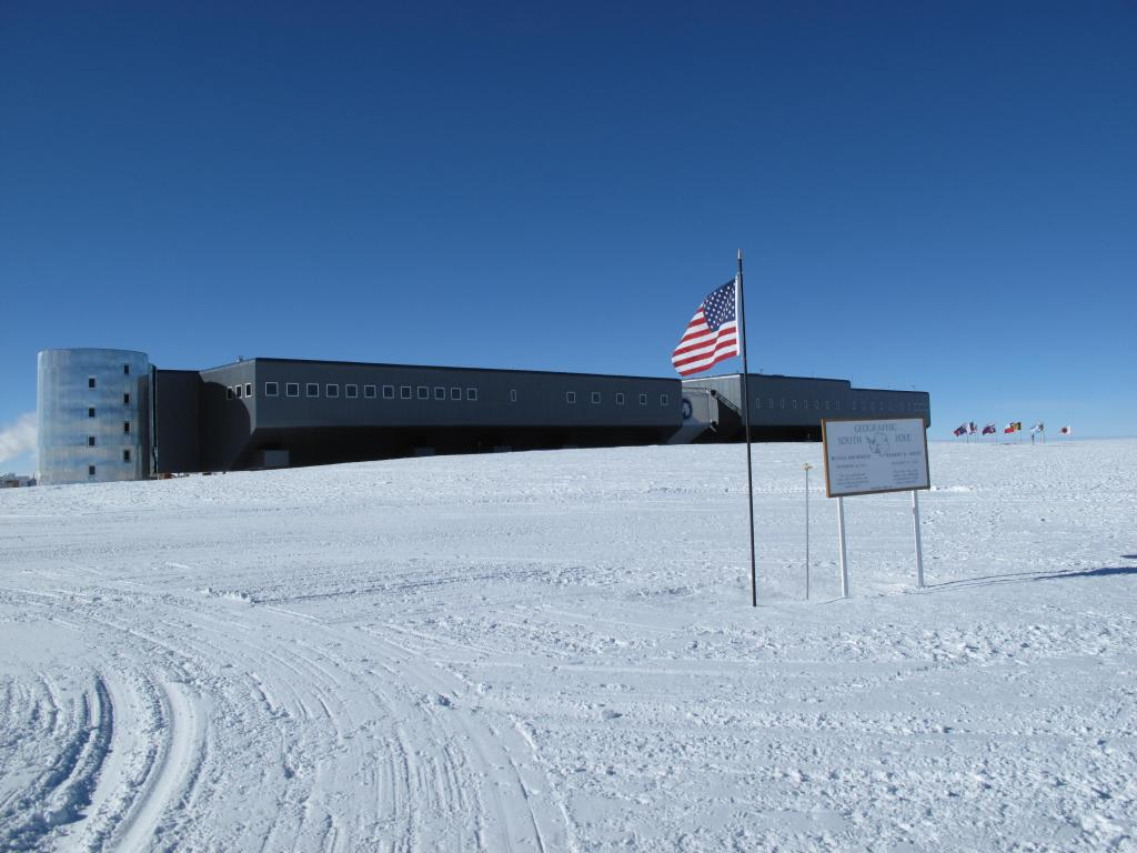 "The geographic South Pole is located a few hundred yards away from the ceremonial South Pole, which is closer to the station. Image Credit: Ted Scambos, NSIDC (<a href=""/cryosphere/gallery/photo/33791"">View photo detail.</a>) <br>"