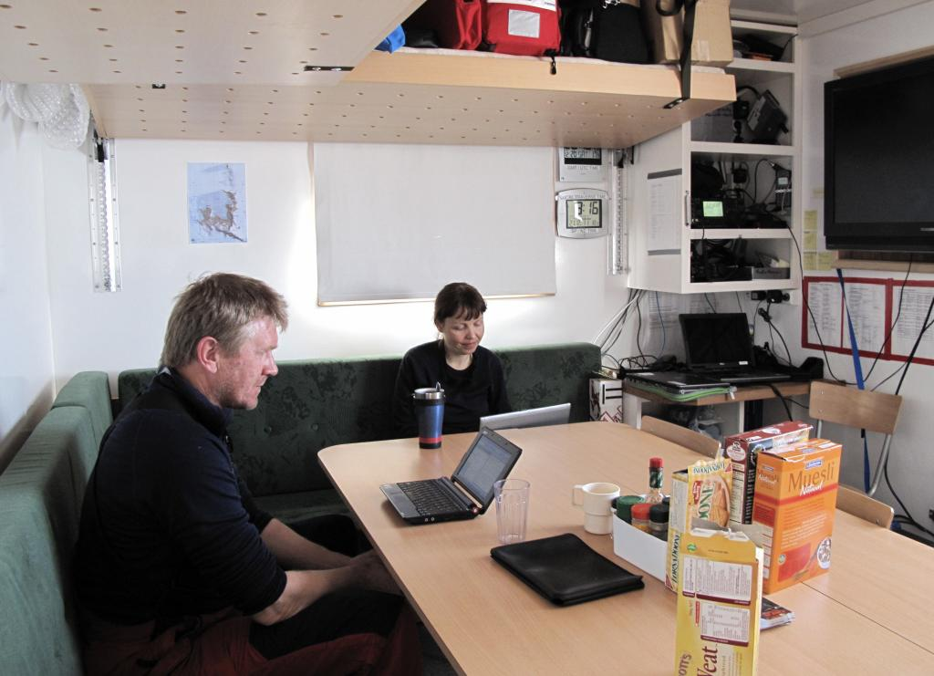 "Team members sit in the dining ""room"" of the traverse caravan. Image Credit: Ted Scambos, NSIDC (<a href=""/cryosphere/gallery/photo/33788"">View photo detail.</a>) <br>"