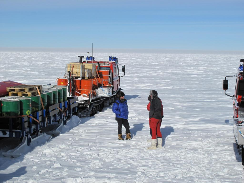 "Researchers enjoy a moment in the sun during the traverse. Image Credit: Ted Scambos, NSIDC (<a href=""/cryosphere/gallery/photo/33799"">View photo detail.</a>) <br>"