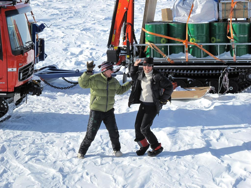 "Researchers enjoy a moment in the sun during the traverse. Image Credit: Ted Scambos, NSIDC (<a href=""/cryosphere/gallery/photo/33802"">View photo detail.</a>) <br>"