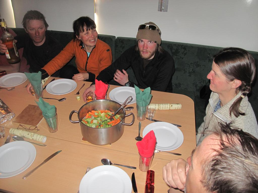 "Inside the dining cabin of the U.S.-Norway Traverse of East Antarctica: the team celebrates Christmas with a special dinner. Image Credit:  Ted Scambos, NSIDC (<a href=""/cryosphere/gallery/photo/33808"">View photo detail.</a>) <br>"