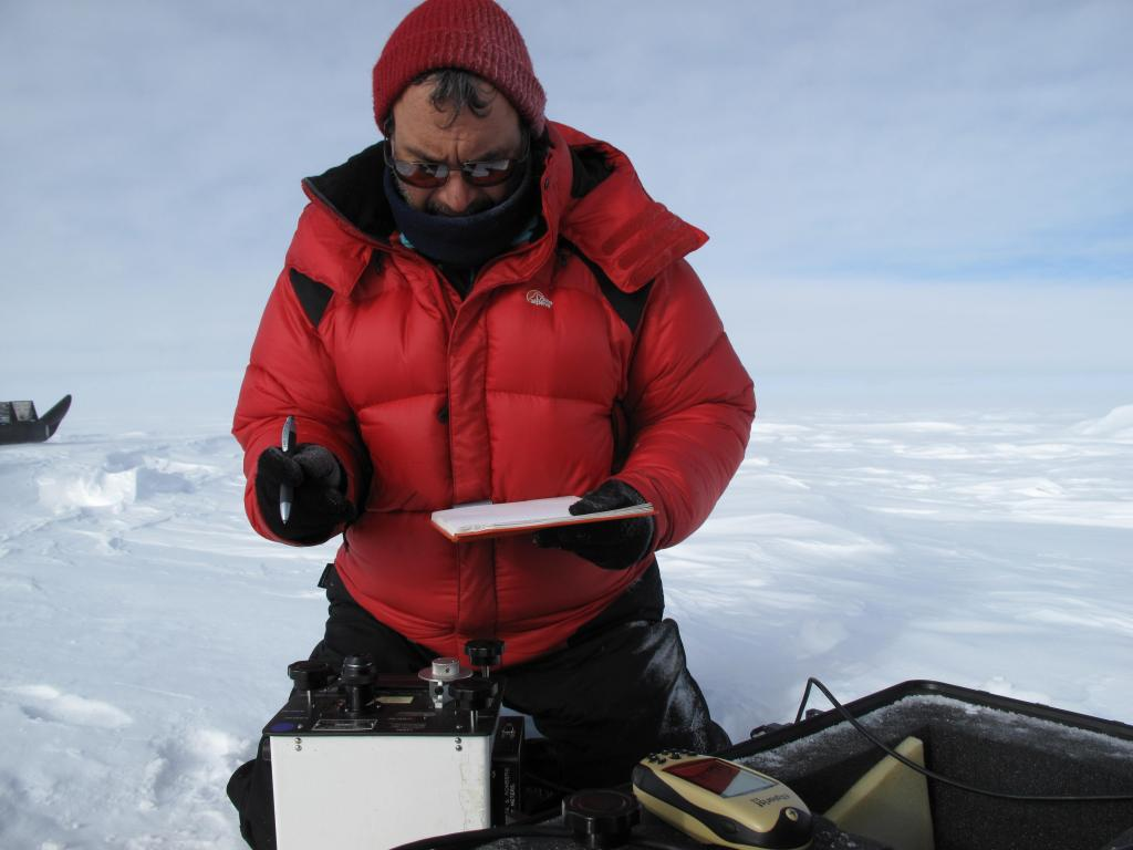 "Ted Scambos takes measurements during the Norwegian-U.S. Scientific Traverse of East Antarctica. Image Credit:  Ted Scambos, NSIDC (<a href=""/cryosphere/gallery/photo/33810"">View photo detail.</a>) <br>"