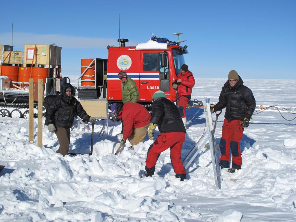 "Researchers set up a weather measurement station during the U.S.-Norway Scientific Traverse of East Antarctica. Image Credit:  Ted Scambos, NSIDC (<a href=""/cryosphere/gallery/photo/33813"">View photo detail.</a>) <br>"