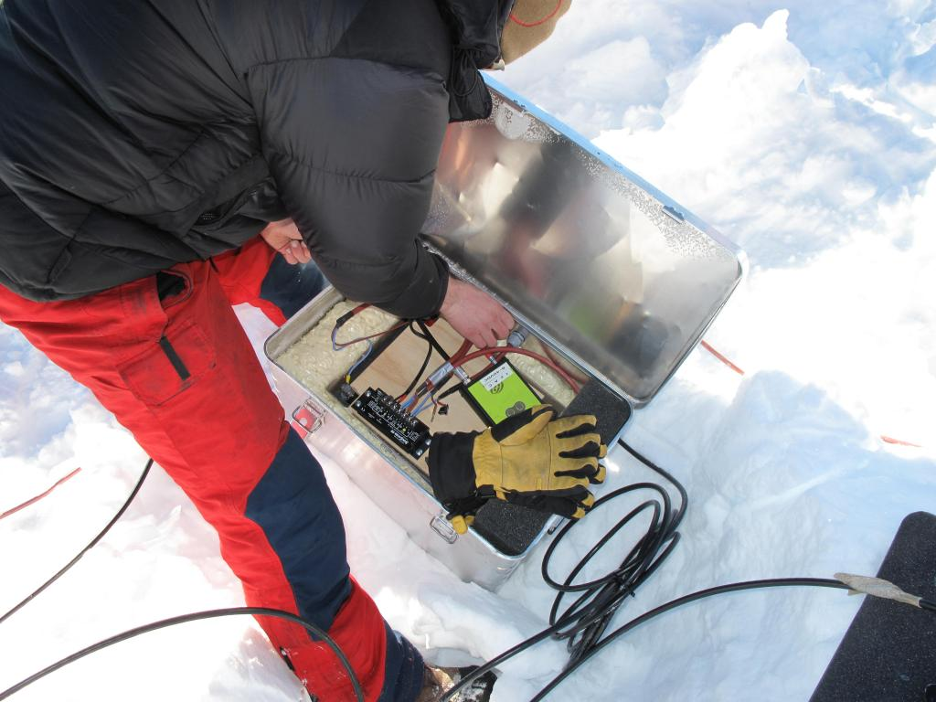 "Researcher sets up equipment during the U.S.-Norway Scientific Traverse of East Antarctica. Image Credit:  Ted Scambos, NSIDC (<a href=""/cryosphere/gallery/photo/33816"">View photo detail.</a>) <br>"