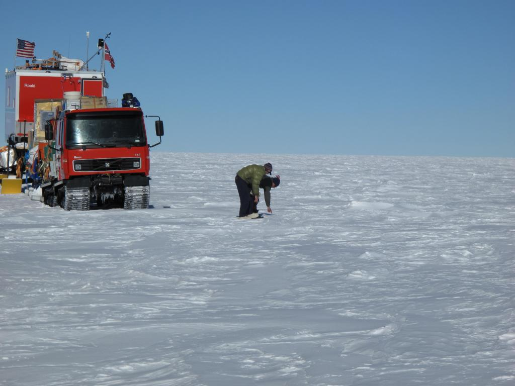 "Researchers stop to check out the snow during the traverse of East Antarctica. Image Credit:  Ted Scambos, NSIDC (<a href=""/cryosphere/gallery/photo/33819"">View photo detail.</a>) <br>"