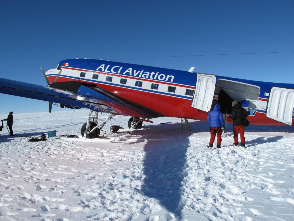 "An airplane waits to pick up the skiers at the end of their race across the Antarctic Ice Sheet. Image Credit:  Ted Scambos, NSIDC (<a href=""/cryosphere/gallery/photo/33832"">View photo detail.</a>) <br>"