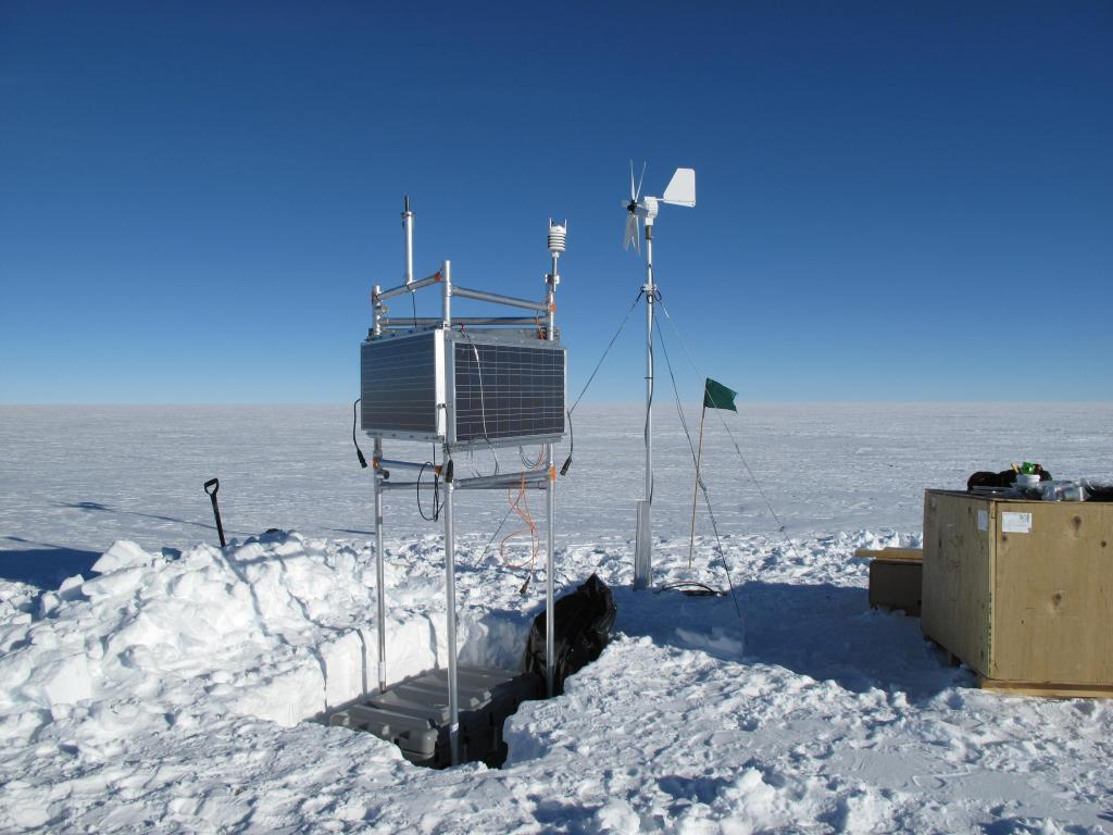 "The traverse team set up this scientific equipment on the Antarctic Ice Sheet. Image Credit:  Ted Scambos, NSIDC (<a href=""/cryosphere/gallery/photo/33829"">View photo detail.</a>) <br>"