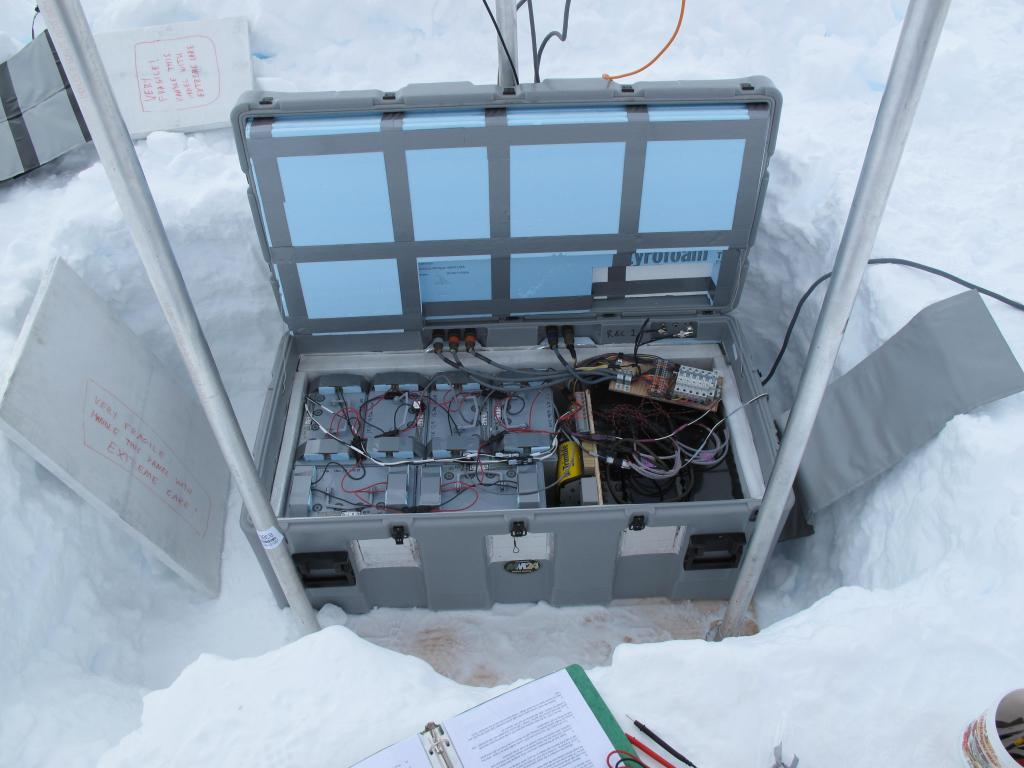 "The traverse team set up this scientific equipment on the Antarctic Ice Sheet. Image Credit:  Ted Scambos, NSIDC (<a href=""/cryosphere/gallery/photo/33834"">View photo detail.</a>) <br>"