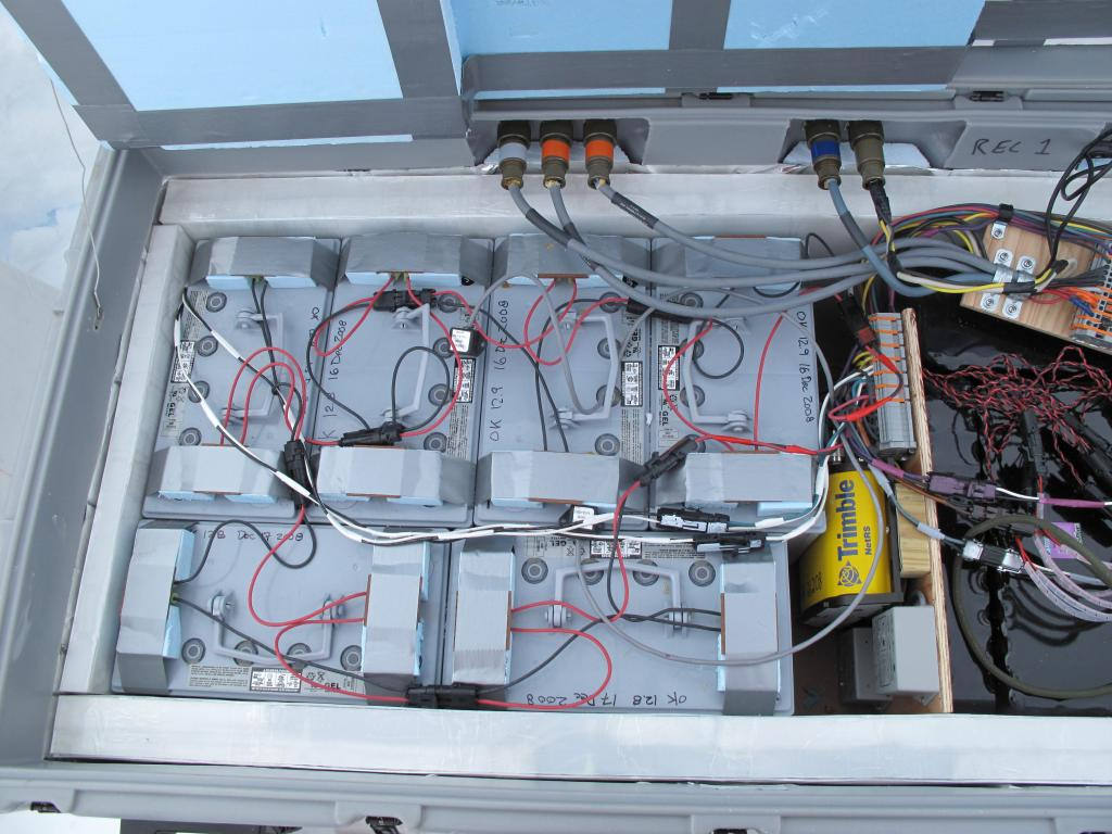 "The traverse team set up this scientific equipment on the Antarctic Ice Sheet. Image Credit:  Ted Scambos, NSIDC (<a href=""/cryosphere/gallery/photo/32991"">View photo detail.</a>) <br>"
