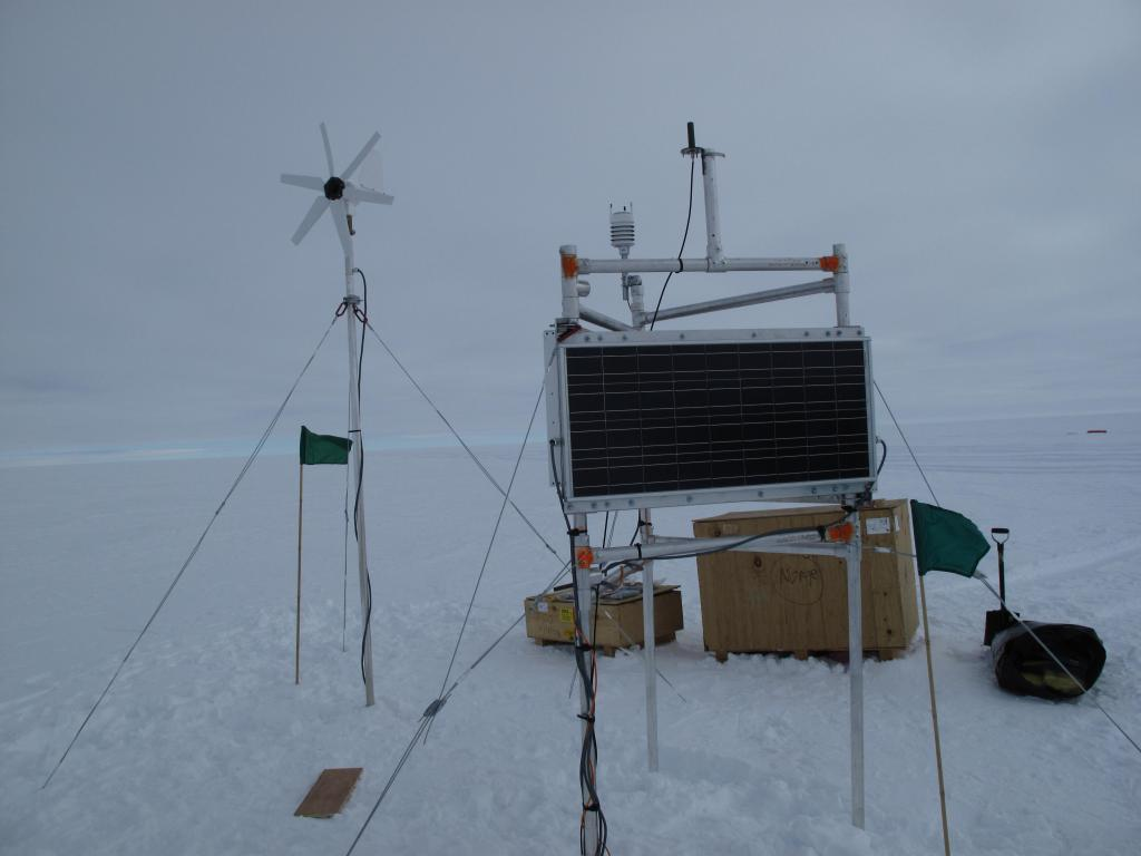 "The traverse team set up this scientific equipment on the Antarctic Ice Sheet. Image Credit:  Ted Scambos, NSIDC (<a href=""/cryosphere/gallery/photo/32992"">View photo detail.</a>) <br>"
