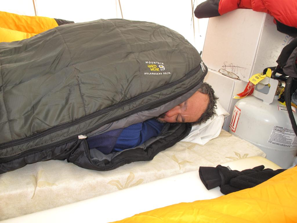 "Ted Scambos snuggles in his sleeping bag, during a side trip of the Norwegian-U.S. Scientific Traverse of East Antarctica. Image Credit:  Ted Scambos, NSIDC (<a href=""/cryosphere/gallery/photo/33835"">View photo detail.</a>) <br>"
