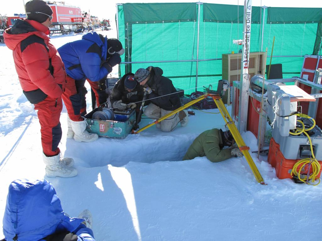 "Scientists dig a snow pit during the Norwegian-U.S. Scientific Traverse of East Antarctica. Image Credit:  Ted Scambos, NSIDC (<a href=""/cryosphere/gallery/photo/33836"">View photo detail.</a>) <br>"