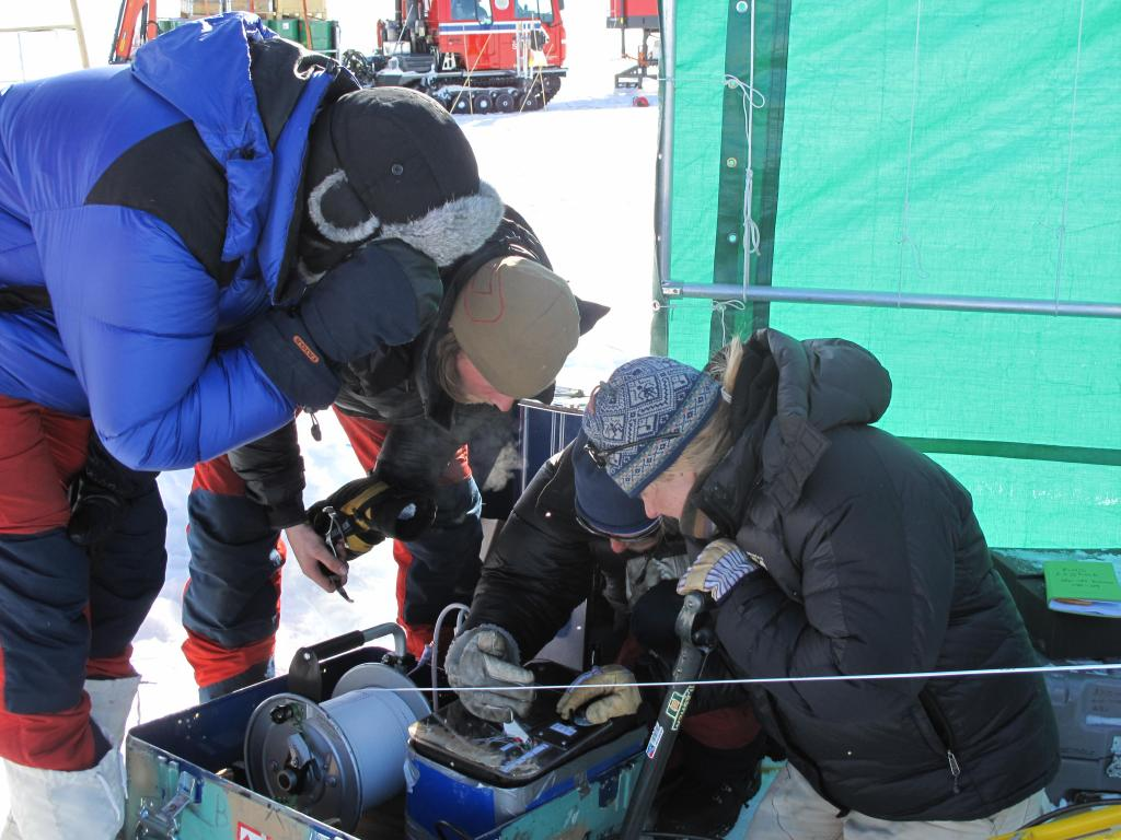 "Scientists examine equipment during the Norwegian-U.S. Scientific Traverse of East Antarctica. Image Credit:  Ted Scambos, NSIDC (<a href=""/cryosphere/gallery/photo/33838"">View photo detail.</a>) <br>"