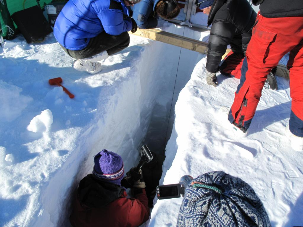 "Scientists dig a snow pit during the Norwegian-U.S. Scientific Traverse of East Antarctica. Image Credit:  Ted Scambos, NSIDC (<a href=""/cryosphere/gallery/photo/33839"">View photo detail.</a>) <br>"