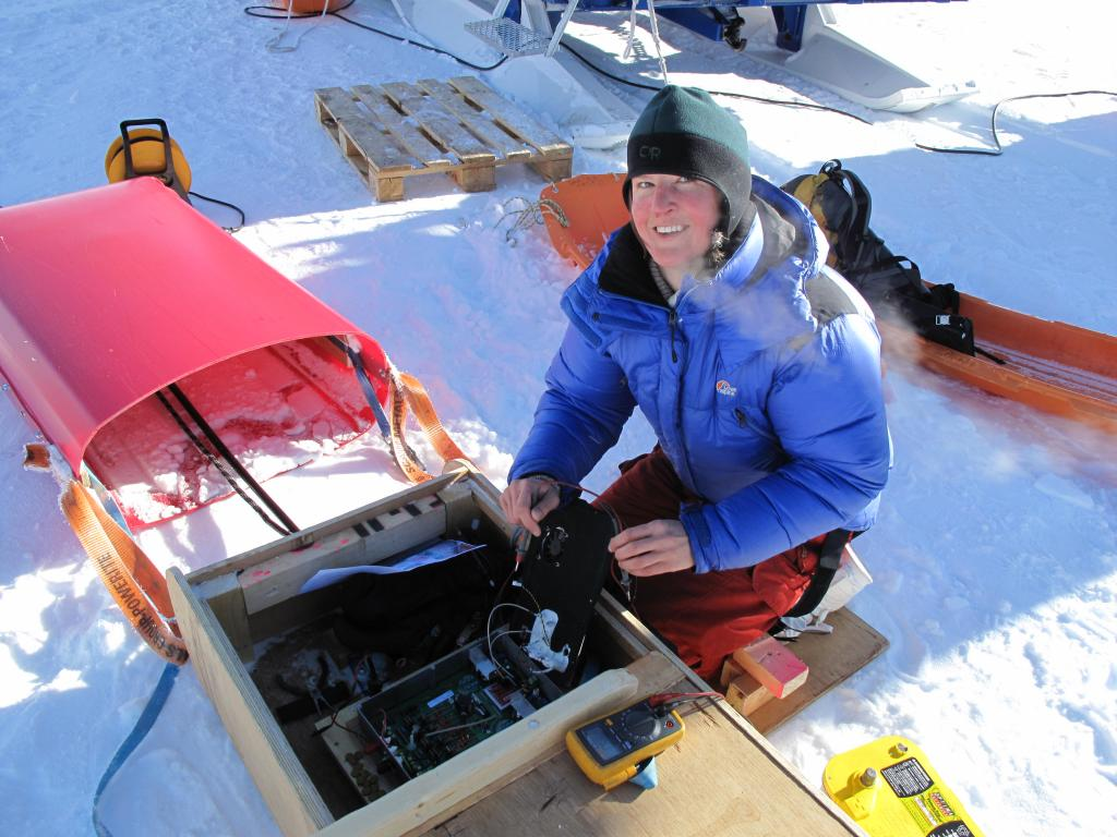 "Researcher works on equipment during the Norwegian-U.S. Scientific Traverse of East Antarctica. Image Credit:  Ted Scambos, NSIDC (<a href=""/cryosphere/gallery/photo/33843"">View photo detail.</a>) <br>"