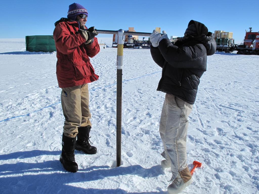 "Researchers take a snow core on the East Antarctic Ice Sheet. Image Credit:  Ted Scambos, NSIDC (<a href=""/cryosphere/gallery/photo/33852"">View photo detail.</a>) <br>"