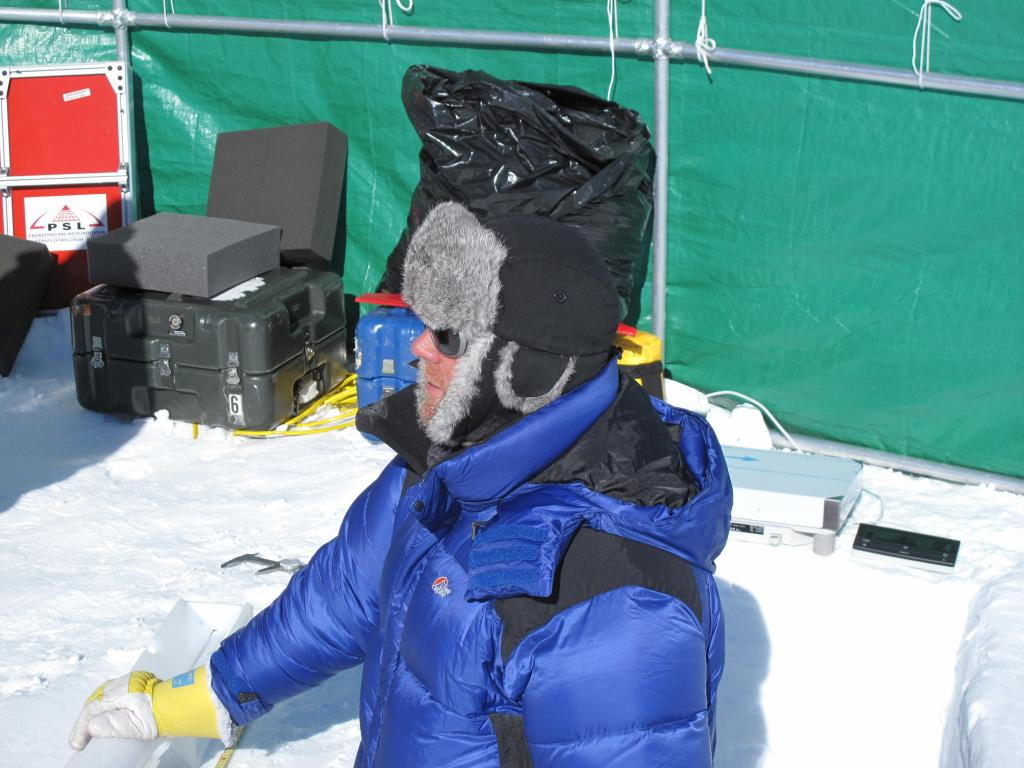 "A wind break protects the researchers from harsh wind while setting up measurements on the East Antarctic Ice Sheet. Image Credit:  Ted Scambos, NSIDC (<a href=""/cryosphere/gallery/photo/33862"">View photo detail.</a>) <br>"