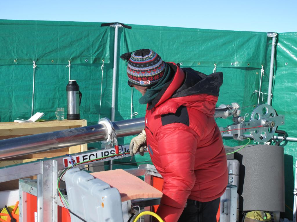 "A wind break protects the researchers from harsh wind while setting up measurements on the East Antarctic Ice Sheet. Image Credit:  Ted Scambos, NSIDC (<a href=""/cryosphere/gallery/photo/33861"">View photo detail.</a>) <br>"