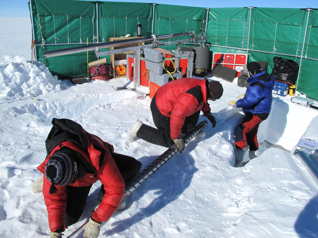 "A wind break protects the researchers from harsh wind while setting up measurements on the East Antarctic Ice Sheet. Image Credit:  Ted Scambos, NSIDC (<a href=""/cryosphere/gallery/photo/33863"">View photo detail.</a>) <br>"
