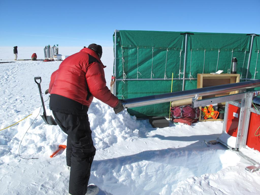 "A wind break protects the researchers from harsh wind while setting up measurements on the East Antarctic Ice Sheet. Image Credit:  Ted Scambos, NSIDC (<a href=""/cryosphere/gallery/photo/33866"">View photo detail.</a>) <br>"