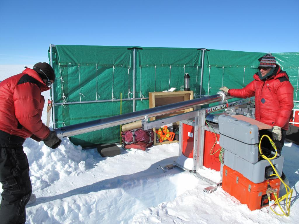 "A wind break protects the researchers from harsh wind while setting up measurements on the East Antarctic Ice Sheet. Image Credit:  Ted Scambos, NSIDC (<a href=""/cryosphere/gallery/photo/33864"">View photo detail.</a>) <br>"