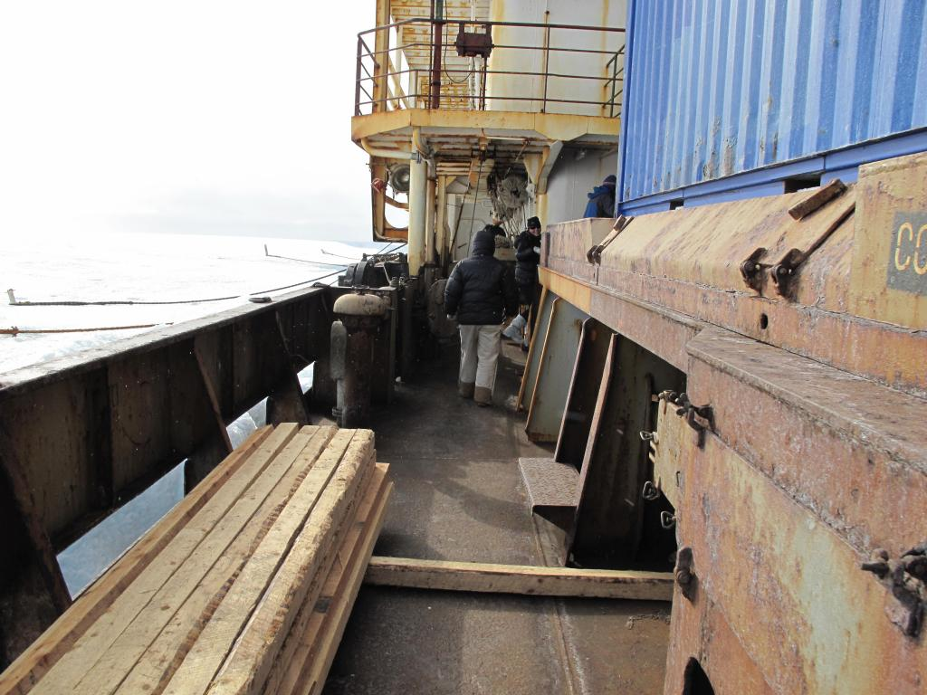 "The traverse team meets a Russian ship to load their equipment for transport back to the mainland. Image Credit:  Ted Scambos, NSIDC (<a href=""/cryosphere/gallery/photo/33888"">View photo detail.</a>) <br>"