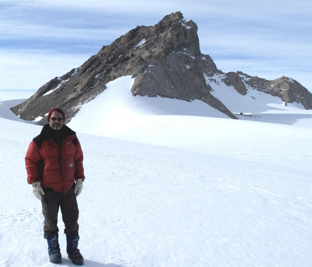 "Ted Scambos poses in front of rocks protruding from the Antarctic Ice Sheet. Image Credit:  Ted Scambos, NSIDC (<a href=""/cryosphere/gallery/photo/33886"">View photo detail.</a>) <br>"