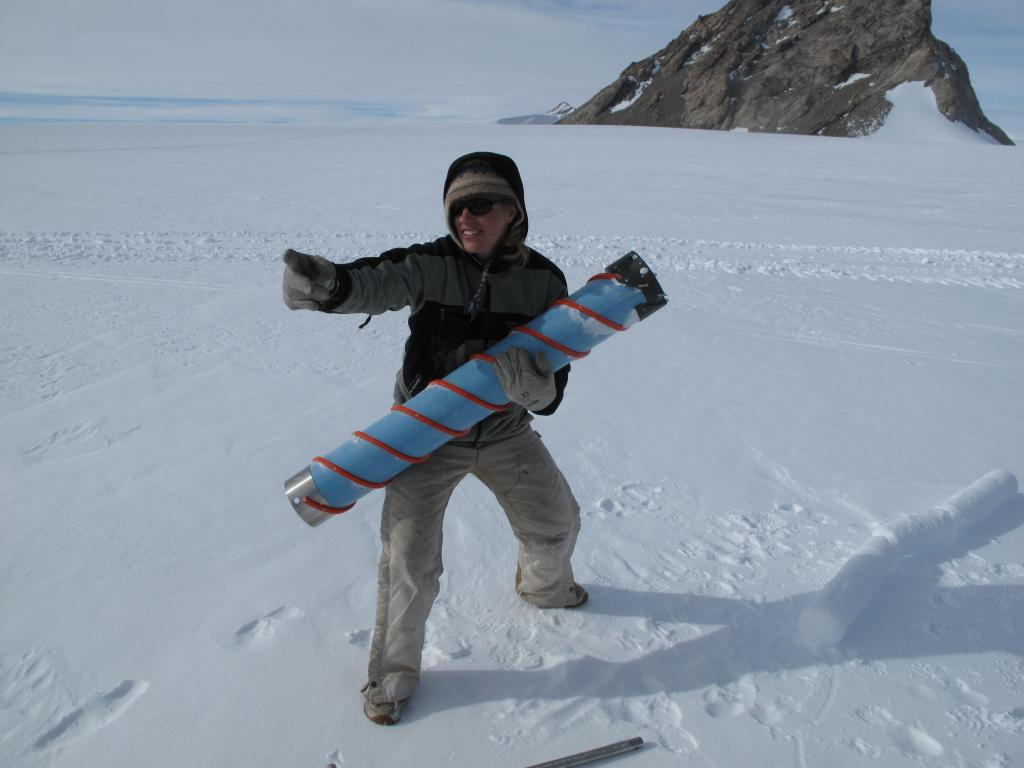 "A researcher hauls a snow core from the traverse vehicles to the ship that will take it back to laboratory.  Image Credit:  Ted Scambos, NSIDC (<a href=""/cryosphere/gallery/photo/33893"">View photo detail.</a>) <br>"
