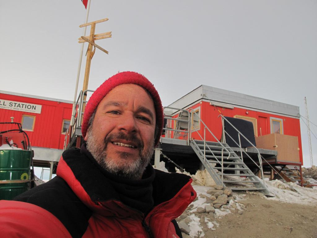 "Ted Scambos poses in front of Troll station, the Norwegian Antarctic research station. Image Credit:  Ted Scambos, NSIDC (<a href=""/cryosphere/gallery/photo/33895"">View photo detail.</a>) <br>"