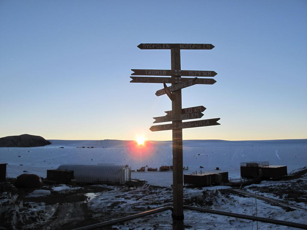 "This sign post shows the direction and distance of the North and South Poles, Tromso, Norway, and other cities. Image Credit:  Ted Scambos, NSIDC (<a href=""/cryosphere/gallery/photo/33896"">View photo detail.</a>) <br>"
