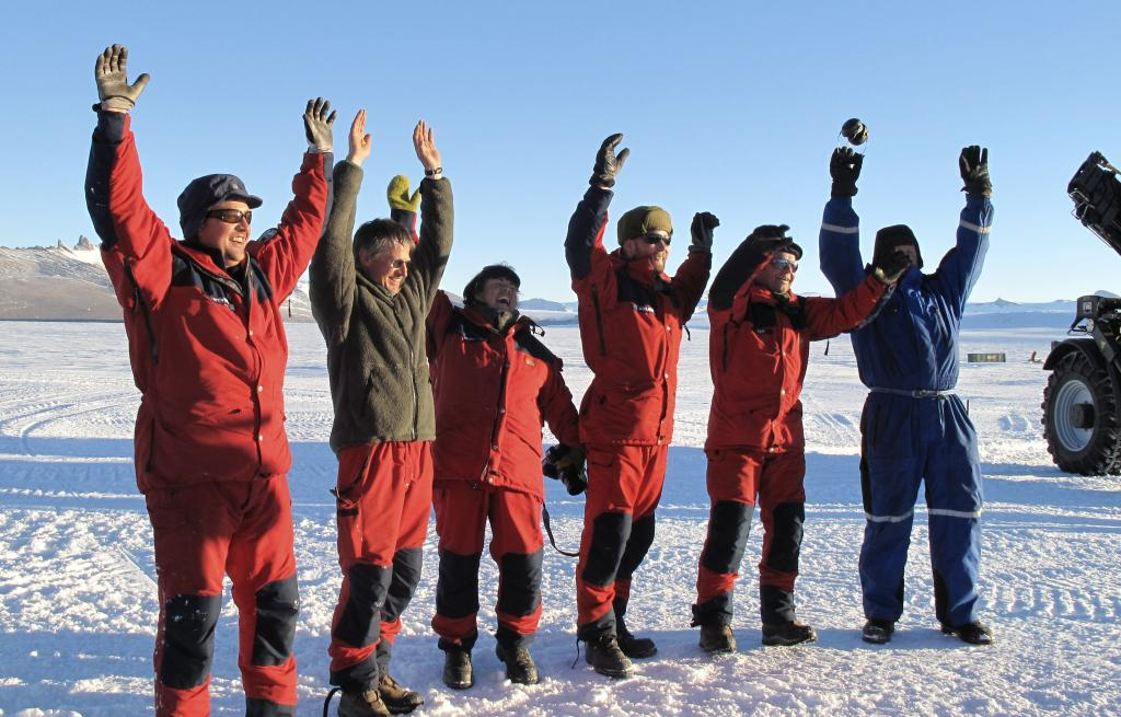 "The team celebrates after reaching Troll Station, the end of the traverse. Image Credit:  Ted Scambos, NSIDC (<a href=""/cryosphere/gallery/photo/33903"">View photo detail.</a>) <br>"