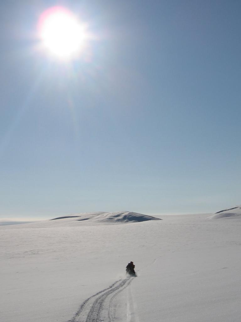 "Scientist speeds off to the research site on snowmobiles. Image courtesy Andrew Slater, NSIDC. (<a href=""/cryosphere/gallery/photo/33648"">View photo detail.</a>) <br>"