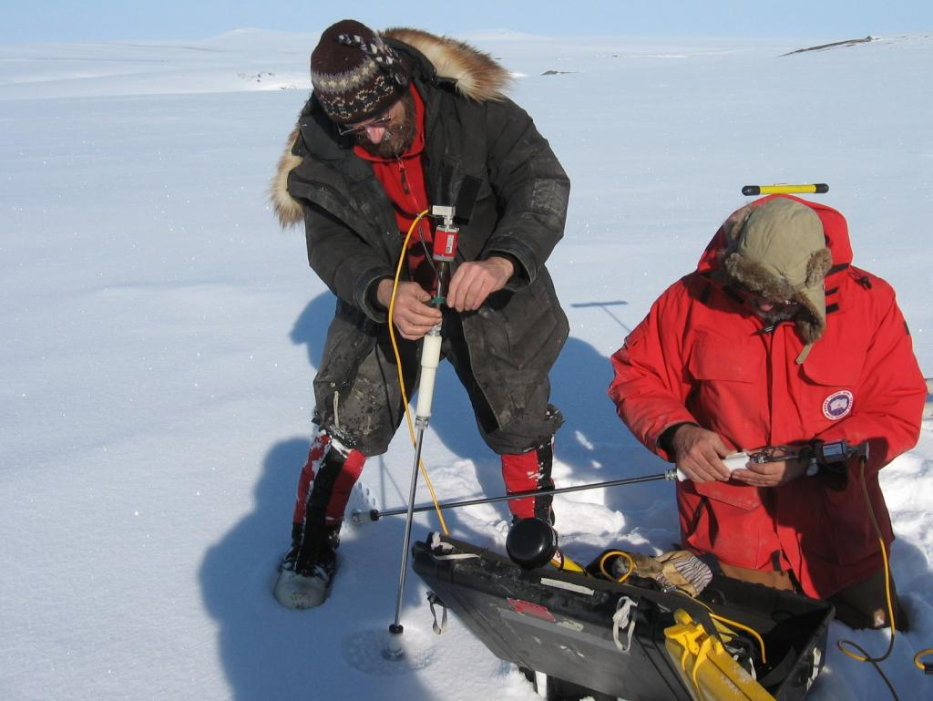 "Matthew Sturm and Mark Serreze set up magna-probes to measure snow depth. Image courtesy Andrew Slater, NSIDC. (<a href=""/cryosphere/gallery/photo/33653"">View photo detail.</a>) <br>"